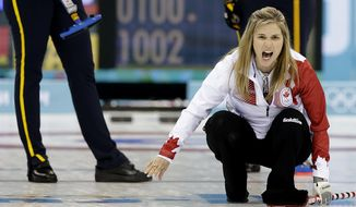 Canada's Jennifer Jones shouts instructions to her teammates during the women's curling gold medal game against Sweden at the 2014 Winter Olympics, Thursday, Feb. 20, 2014, in Sochi, Russia. (AP Photo/Wong Maye-E)