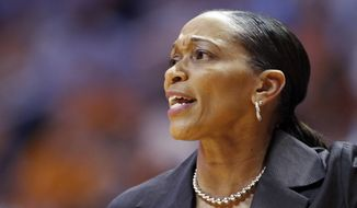Auburn head coach Terri Williams-Flournoy yells to her player's in the first half of an NCAA college basketball game against the Tennessee, Thursday, Feb. 20, 2014, in Knoxville, Tenn. (AP Photo/Wade Payne)
