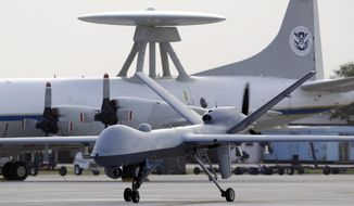 FILE - In this Nov. 8, 2011 file photo, a Predator B unmanned aircraft taxis at the Naval Air Station in Corpus Christi, Texas. A U.S. military drone strike in Yemen in December 2013 may have killed up to a dozen civilians on their way to a wedding and injured others, including the bride, a human rights group says. U.S. officials say only members of al-Qaida were killed, but they have refused make public the details of two U.S. investigations into the incident.(AP Photo/Eric Gay, File)