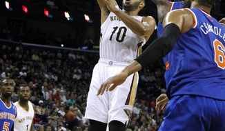 New Orleans Pelicans shooting guard Eric Gordon (10) shoots the ball during the second half of an NBA basketball game against the New York Knicks in New Orleans, Wednesday, Feb. 19, 2014. The Knicks won 98-91. (AP Photo/Jonathan Bachman)