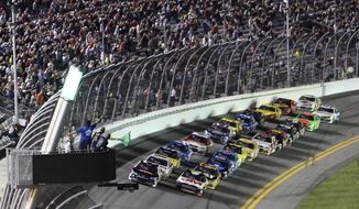 Austin Dillon, left, and Greg Biffle, right, lead the field at the start of the first of two NASCAR Sprint Cup Series qualifying auto races at Daytona International Speedway in Daytona Beach, Fla., Thursday, Feb. 20, 2014. (AP Photo/David Graham)