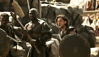 "Kit Harrington (right) stars with Adewale Akinnuoye-Agbaje in ""Pompeii."" Mr. Harrington plays Milo, a slave thrust into ancient gladiatorial combat. (Rex Features/Associated Press)"