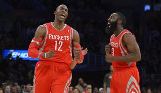 Houston Rockets center Dwight Howard, left, and guard James Harden reacts after Howard was called for a technical foul during the first half of an NBA basketball game against the Los Angeles Lakers, Wednesday, Feb. 19, 2014, in Los Angeles. (AP Photo/Mark J. Terrill)