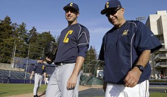 In this Feb. 19, 2014 photo, California baseball coach David Esquer, right, walks off the field with pitcher Kyle Porter after a team practice  in Berkeley, Calif. While in the midst of taking classes at California and simultaneously pondering his collegiate baseball future after his sport got cut, pitcher Kyle Porter considered leaving Berkeley for Oregon in early 2011 to play for the Ducks immediately that season. (AP Photo/Ben Margot)