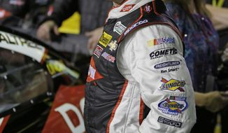 Austin Dillon laughs as he prepares to climb into his car before the first of two NASCAR Sprint Cup series qualifying auto races at Daytona International Speedway in Daytona Beach, Fla., Thursday, Feb. 20, 2014. (AP Photo/John Raoux)