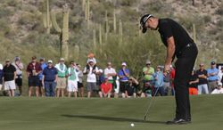 Henrik Stenson, of Sweden, putts on the 17th hole in his match against Kiradech Aphibanrat during the first round of the Match Play Championship golf tournament2 Wednesday, Feb. 19, 2014, in Marana, Ariz. Stenson won 2 and 1. (AP Photo/Ted S. Warren)