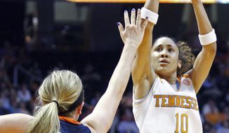 Tennessee guard Meighan Simmons (10) shoots over Auburn guard/forward Katie Frerking (13) in the first half of an NCAA college basketball game, Thursday, Feb. 20, 2014, in Knoxville, Tenn. (AP Photo/Wade Payne)