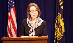 Oregon Attorney General Ellen Rosenblum reads a statement at the State Capitol in Salem, Ore., on Thursday, Feb. 20, 2014, modifying the State of Oregon's legal position in federal lawsuits that challenge Oregon's ban on same-sex marriage. (AP Photo/Statesman Journal, Thomas Patterson)