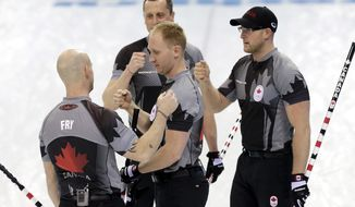 Canada's men's curling team as seen from left to right, Ryan Fry, E.J. Harnden, Brad jacobs and Ryan Harnden celebrate after beating China in the men's curling semifinal game at the 2014 Winter Olympics, Wednesday, Feb. 19, 2014, in Sochi, Russia. (AP Photo/Wong Maye-E)