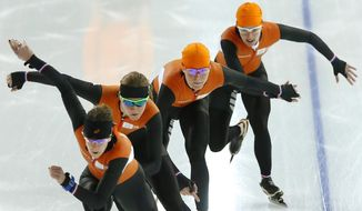 Dutch speedskaters practice during a training session at the 2014 Winter Olympics in Sochi, Russia, Thursday, Feb. 20, 2014. (AP Photo/Patrick Semansky)