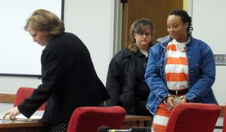 In this Feb. 14, 2014 photo Kristen Smith, arrives for a hearing in Tipton, Iowa. A federal grand jury has indicted Smith, Wednesday, Feb. 19, on federal charges alleging that she kidnapped her half sister's newborn from Wisconsin and left him behind an Iowa gas station in freezing weather. (AP Photo/Ryan J. Foley)