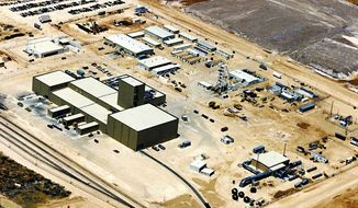FILE - This undated file aerial photo shows the Waste Isolation Pilot Plant near Carlsbad, N.M. The U.S. Department of Energy has appointed a team to investigate the detection of radiation in and near the Waste Isolation Pilot Plant facility that's the nation's only underground nuclear waste repository in operation. An underground monitor at the plant near Carlsbad detected airborne radiation late Friday night, Feb. 14, and an independent monitor center said Wednesday, Feb. 19, 2014 that it found radioactive isotopes in an air sensor a half-mile from the plant. The assessment of facility will be conducted by an accident investigation board consisting of department officials and representatives of health and safety agencies, the department said in a statement released late Wednesday, Feb. 19, 2014.  (AP Photo/Carlsbad Current Argus, File)