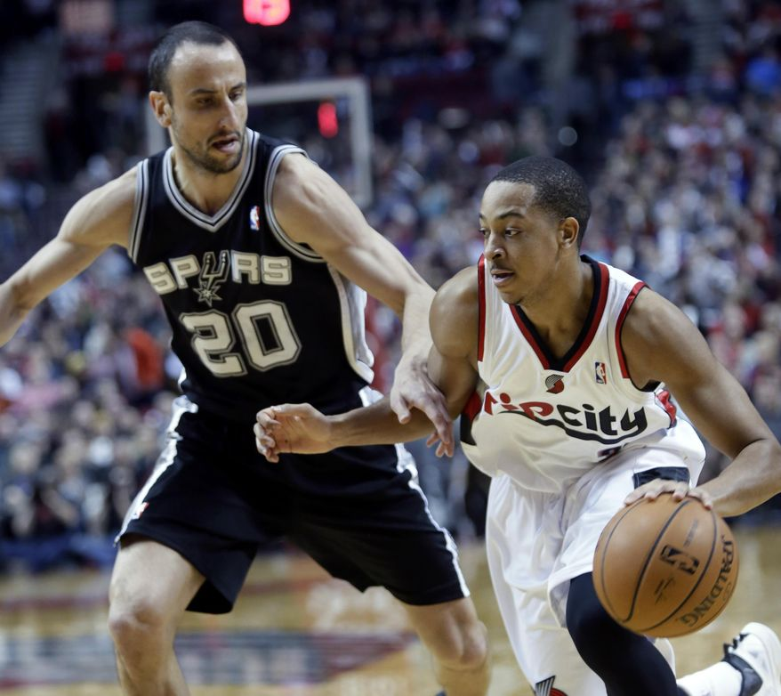 Portland Trail Blazers guard CJ McCollum, right, drives on San Antonio Spurs guard Manu Ginobli, from Argentina, during the first half of an NBA basketball game in Portland, Ore., Wednesday, Feb. 19, 2014.(AP Photo/Don Ryan)