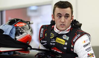 Austin Dillon climbs into his car before practice for Sunday's NASCAR Daytona 500 Sprint Cup Series auto race at Daytona International Speedway in Daytona Beach, Fla., Wednesday, Feb. 19, 2014. (AP Photo/Terry Renna)