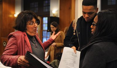 University of Michigan provost Martha Pollack speaks with Tyrell Collier and Shayla Scales, both seniors and members of the Black Student Union, after a Board of Regents meeting Thursday, Feb. 20 at the Michigan Union in Ann Arbor, Mich. (AP Photo/The Ann Arbor News, Brianne Bowen)