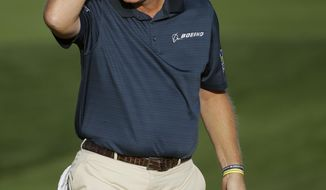 Ernie Els, of South Africa, wipes his head after winning his match against Justin Rose, of England, during the second round of the Match Play Championship golf tournament on Thursday, Feb. 20, 2014, in Marana, Ariz. (AP Photo/Ted S. Warren)