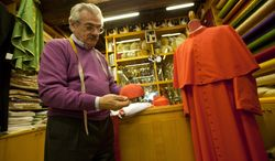 """Raniero Mancinelli shows a cardinal's skull cap in his tailor shop in Rome, Thursday Feb. 13, 2014. No glitzy gold, no rich velvet, no regal fur but rather sensible black shoes and a white cassock so flimsy you can see his black trousers through it. Pope Francis has pared down the papal wardrobe to fit his call for simplicity and humility among his clergy. The pope's personal style _ which earned him Esquire magazine's """"Best Dressed Man of 2013"""" award _ and his broader message of sobriety will be put to the test Saturday when he inducts 19 prelates into the College of Cardinals, placing the three-cornered red silk biretta on the heads of the new """"princes of the church."""" (AP Photo/Alessandra Tarantino)"""