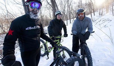 ADVANCE FOR MODAY, FEB. 24 AND THEREAFTER - In a Thursday, Feb. 6, 2014 photo, Winona Area Mountain Bikers members, from left, Scott Sherman of Winona, Minn., Jeremy Staff of Minnesota City, Minn., and Brian George of Holmen, Wis., pose for a photo with their fat tire trail bikes, in Winona, Minn. (AP Photo/Winona Daily News, Andrew Link)