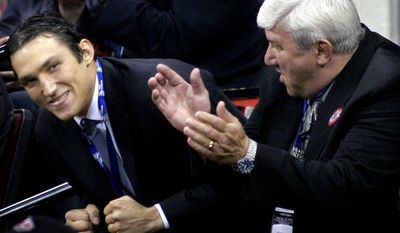 **FILE** Alexander Ovechkin, left, of Russia reacts after being selected as the first overall pick by the Washington Capitals during the NHL Draft, Saturday, June 26, 2004, at the RBC Center in Raleigh, N.C. At right is Ovechkin's father Mikhail Ovechkin. (AP Photo/Grant Halverson)