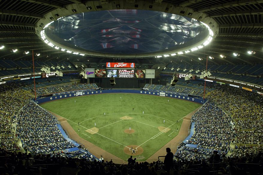 Baeball fans fill Olympic Stadium to watch the MontrealExpos play their final home game against the Florida Marlins in Montreal, Wednesday, Sept. 29, 2004. The Expos will move to Washington, D.C. for next season. (AP PHOTO/Paul Chiasson)