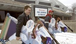 Montreal Expos fans Jean-Franois Reid, left, and Dave Kaufman leave with team souvenirs as the Expos store is holding a liquidation sale at the Olympic Stadium on Friday, Dec. 3, 2004. (AP PHOTO/La Presse, Andr Pichette)