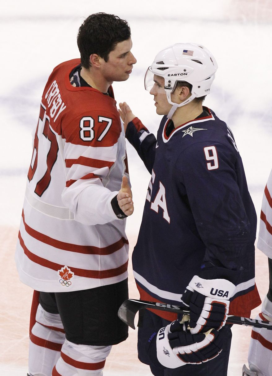 Canada's Sidney Crosby (87) and USA's Zach Parise (9) greet one another after Canada beat the USA 3-2 in the overtime period of a men's gold medal ice hockey game at the Vancouver 2010 Olympics in Vancouver, British Columbia, Sunday, Feb. 28, 2010. (AP Photo/Chris O'Meara)