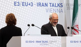 European Union High Representative Catherine Ashton and Iranian Foreign Minister Mohammad Javad Zarif, right, speak to the press after closed-door nuclear talks in Vienna, Austria, Thursday, Feb. 20, 2014. Iran and six world powers are back at the negotiating table eager to come to terms on a comprehensive nuclear deal but deeply divided on what it should look like. The two sides began meeting Tuesday in attempts to build on a first-step accord that temporarily curbs Tehran's nuclear activities in exchange for some sanctions relief. (AP Photo/Ronald Zak)