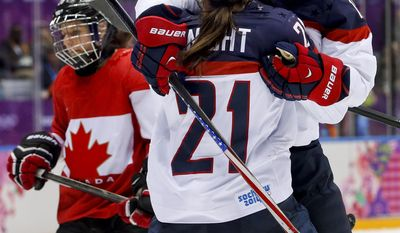 Hilary Knight of the United States (21) celebrates with teammate Kelli Stack (16)  after Alex Carpenter of the United States (25) scored a goal against Canada during the third period of the women's gold medal ice hockey game at the 2014 Winter Olympics, Thursday, Feb. 20, 2014, in Sochi, Russia. (AP Photo/Mark Humphrey)