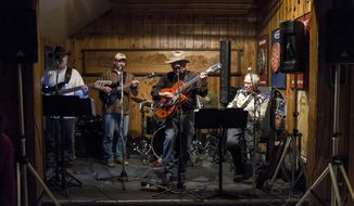 In this Jan. 26, 2014 photo, the Stagecoach Band, featuring original member Bill Briggs, seated at right, performs a show at the Stagecoach Bar in Wilson, Wyo. Briggs will mark the band's 45th anniversary of weekly Sunday evening shows on Feb. 16, 2014. (AP Photo/Casper Star-Tribune, Ryan Dorgan)