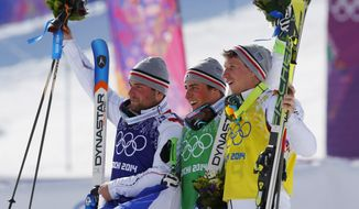 Men's ski cross gold medalist Jean Frederic Chapuis of France, center, celebrates with silver medalist Arnaud Bovolenta of France, left, and bronze medalist Jonathan Midol of France, at the Rosa Khutor Extreme Park, at the 2014 Winter Olympics, Thursday, Feb. 20, 2014, in Krasnaya Polyana, Russia.  (AP Photo/Sergei Grits)