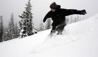In this Feb. 6, 2014 photo, Mark Morical carves through the heavy powder snow at the top of Vista Butte west of Bend, Ore. (AP Photo/The Bulletin, Joe Kline)