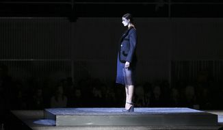 A model wears a creation for Prada women's Fall-Winter 2014-15 collection, part of the Milan Fashion Week, unveiled in Milan, Italy, Thursday, Feb. 20, 2014. (AP Photo/Antonio Calanni)