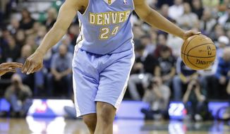 In this Nov. 11, 2013, photo, Denver Nuggets' Andre Miller brings the ball up during an NBA basketball game against the Utah Jazz in Salt Lake City. The Washington Wizards, pushing for their first playoff berth since 2008, acquired Miller from the Nuggets on Thursday, Feb. 20, 2014, in a three-way trade that also involves the Philadelphia 76ers. The Wizards gave up two seldom-used players--forward Jan Vesely and point guard Eric Maynor. Vesely goes to the Nuggets, while Maynor gets shipped to the 76ers. (AP Photo/Rick Bowmer)