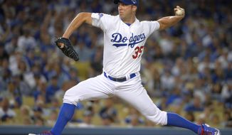 FILE - This Oct. 6, 2013 file photo shows Los Angeles Dodgers pitcher Chris Capuano throwing in the fourth inning in Game 3 of the National League division baseball series against the Atlanta Braves in Los Angeles. The Boston Red Sox have reached agreement with Capuano on a $2.25 million, one-year contract, according to a person familiar with the situation, Thursday, Feb. 20, 2014. (AP Photo/Mark J. Terrill, file)