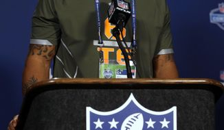 North Carolina tight end Eric Ebron answers a question during a news conference at the NFL football scouting combine in Indianapolis, Thursday, Feb. 20, 2014. (AP Photo/Michael Conroy)