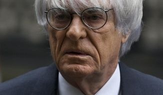 FILE - In this Nov. 11, 2013 file picture President and CEO of Formula One Management Bernie Ecclestone arrives for his case at the High Court in London.  Formula 1 boss Bernie Ecclestone has won a multimillion-dollar case at London's High Court  Thursday Feb. 20, 2014,relating to the sale of F1 in 2005 but the judge nevertheless said it was a corrupt deal. A former F1 shareholder, German media company Constantin Medien, had sued Ecclestone and other defendants for up to $144 million, claiming F1 was undervalued at the time of the sale to investment group CVC Capital Partners. (AP Photo/Matt Dunham. File)