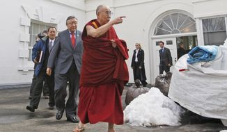 ** FILE ** In this Feb. 18, 2010, file photo, The Dalai Lama walks out of the White House in Washington, after meeting with President Barack Obama. Obama will host Tibetan spiritual leader the Dalai Lama for a meeting on Feb. 21, 2014, the White House said, in a move that could rankle already tense relations between the U.S. and China. (AP Photo/Charles Dharapak, File)