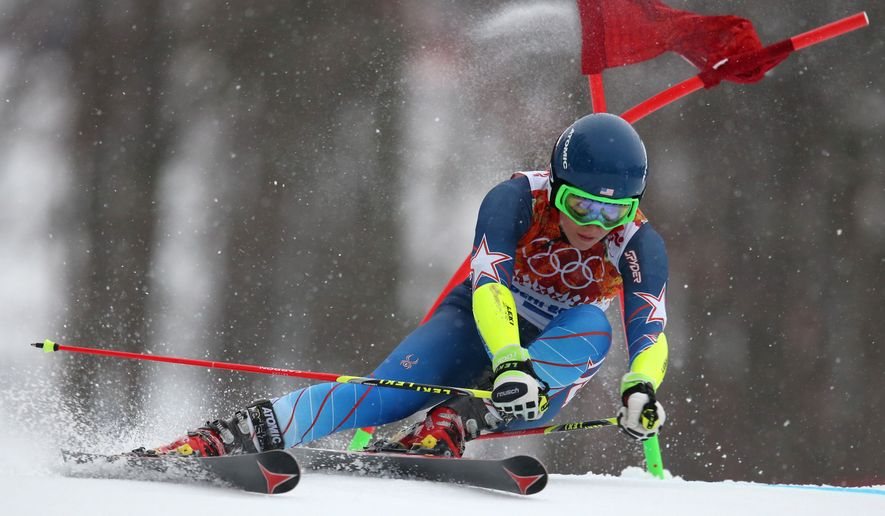 United States' Mikaela Shiffrin passes a gate in the first run of the women's giant slalom at the Sochi 2014 Winter Olympics, Tuesday, Feb. 18, 2014, in Krasnaya Polyana, Russia. (AP Photo/Alessandro Trovati)