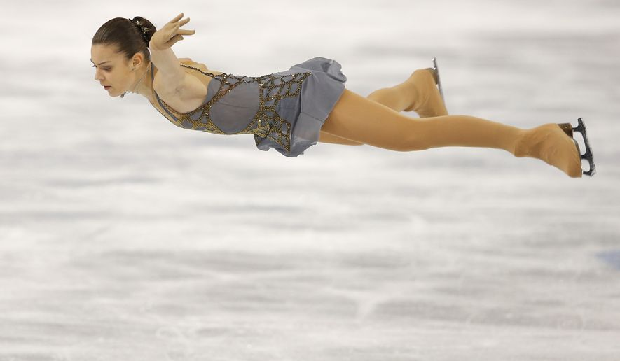 Adelina Sotnikova of Russia competes in the women's free skate figure skating finals at the Iceberg Skating Palace during the 2014 Winter Olympics, Thursday, Feb. 20, 2014, in Sochi, Russia. (AP Photo/Vadim Ghirda)