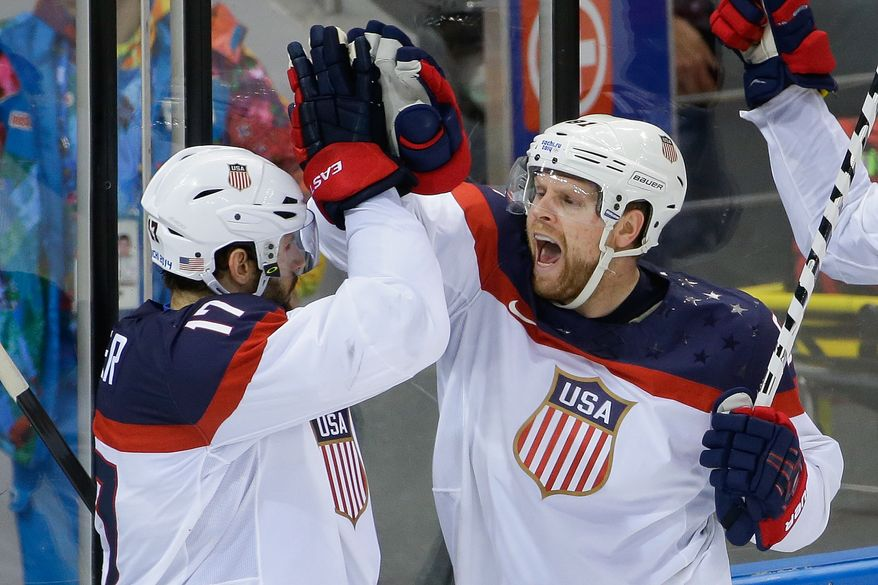 USA forward Phil Kessel, right, reacts to his goal with teammate Ryan Kesler during the third period of men's quarterfinal hockey game against the Czech Republic in Shayba Arena at the 2014 Winter Olympics, Wednesday, Feb. 19, 2014, in Sochi, Russia. (AP Photo/Matt Slocum)