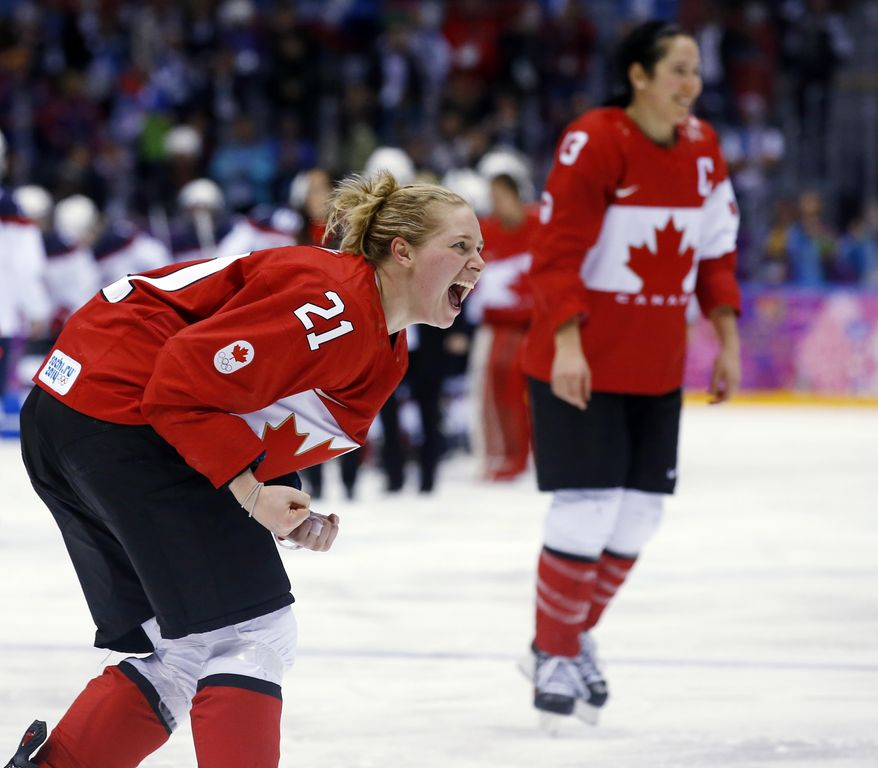 Haley Irwin of Canada (21) reacts after Canada beat the USA 3-2 to win the women's gold medal ice hockey game in overtime at the 2014 Winter Olympics, Thursday, Feb. 20, 2014, in Sochi, Russia. (AP Photo/Matt Slocum)