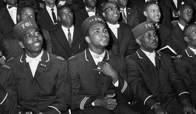 ADVANCE FOR USE SUNDAY, FEB. 23, 2014 AND THEREAFTER - FILE - In this Feb. 28, 1966 file photo, Muhammad Ali listens to Elijah Muhammad as he speaks to other black Muslims in Chicago. (AP Photo/Paul Cannon)