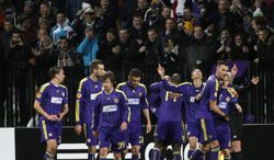 Players of Maribor celebrate their first goal against Sevilla  during their Europa League round of 32, first leg soccer match, in Maribor, Slovenia, Thursday, Feb. 20, 2014. (AP Photo/Filip Horvat)