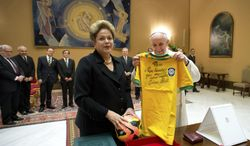 In this photo provided by the Vatican newspaper L'Osservatore Romano, Pope Francis exchanges gifts with Brazilian President Dilma Rousseff during their audience at the Vatican, Friday, Feb. 21, 2014.  (AP Photo/L'Osservatore Romano, ho)