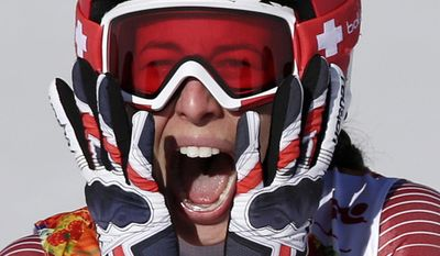 Switzerland's Dominique Gisin reacts after finishing the women's downhill the Sochi 2014 Winter Olympics, Wednesday, Feb. 12, 2014, in Krasnaya Polyana, Russia. She tied for first place with Slovenia's Tina Maze to win the gold medal. (AP Photo/Gero Breloer, File)