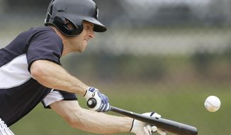 New York Yankees center fielder Brett Gardner bunts during spring training baseball practice Friday, Feb. 21, 2014, in Tampa, Fla. (AP Photo/Charlie Neibergall)