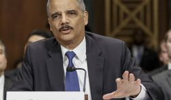 FILE - In this Jan. 29, 2014, file photo, Attorney General Eric Holder testifies on Capitol Hill in Washington. The Justice Department announced Feb. 21, 2014, it is revising its rules for obtaining records from the news media in leak investigations, promising that in most instances the government will notify news organizations beforehand of its intention to do so. The revised procedures are designed to give news organizations an opportunity to challenge any subpoenas or search warrants in federal court.  (AP Photo/J. Scott Applewhite, File)