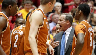 Texas coach Rick Barnes talks toi his players during a timeout in the first half of an NCAA college basketball game against Iowa State at Hilton Coliseum in Ames, Iowa, Tuesday, Feb. 18, 2014. (AP Photo/Justin Hayworth)