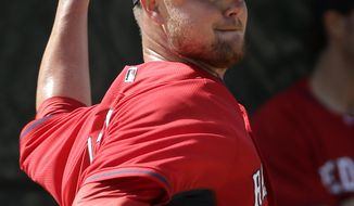 Boston Red Sox starting pitcher Jon Lester winds up for a throw during spring training baseball practice Thursday, Feb. 20, 2014, in Fort Myers, Fla. (AP Photo/Steven Senne)