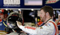 Dale Earnhardt Jr. gets ready for a practice session for the Daytona 500 NASCAR Sprint Cup Series auto race at Daytona International Speedway in Daytona Beach, Fla., Friday, Feb. 21, 2014. (AP Photo/John Raoux)